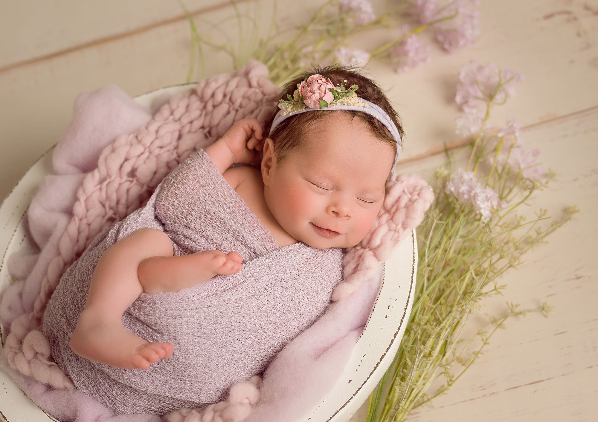 Newborn Shooting mit Wickeltechnik